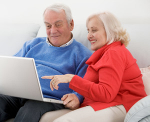 Senior-Couple-on-Sofa-with-Laptop